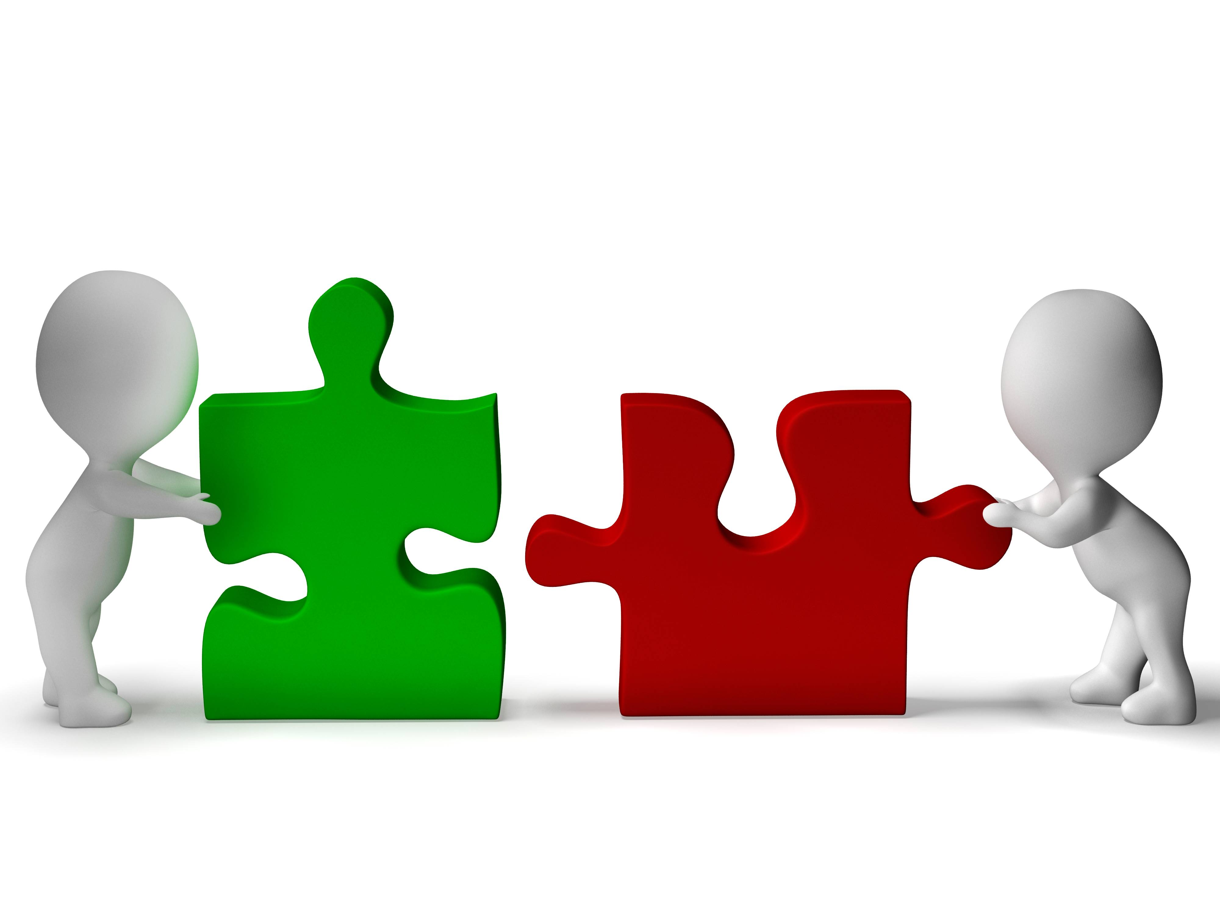 5343073-jigsaw-pieces-being-joined-shows-teamwork-and-collaboration.jpg