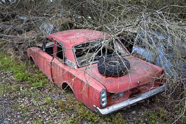 An abandoned car that was wrecked in an accident
