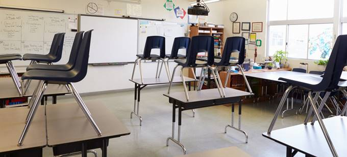 15835561-empty-classroom-with-chairs-on-tables_1.jpg